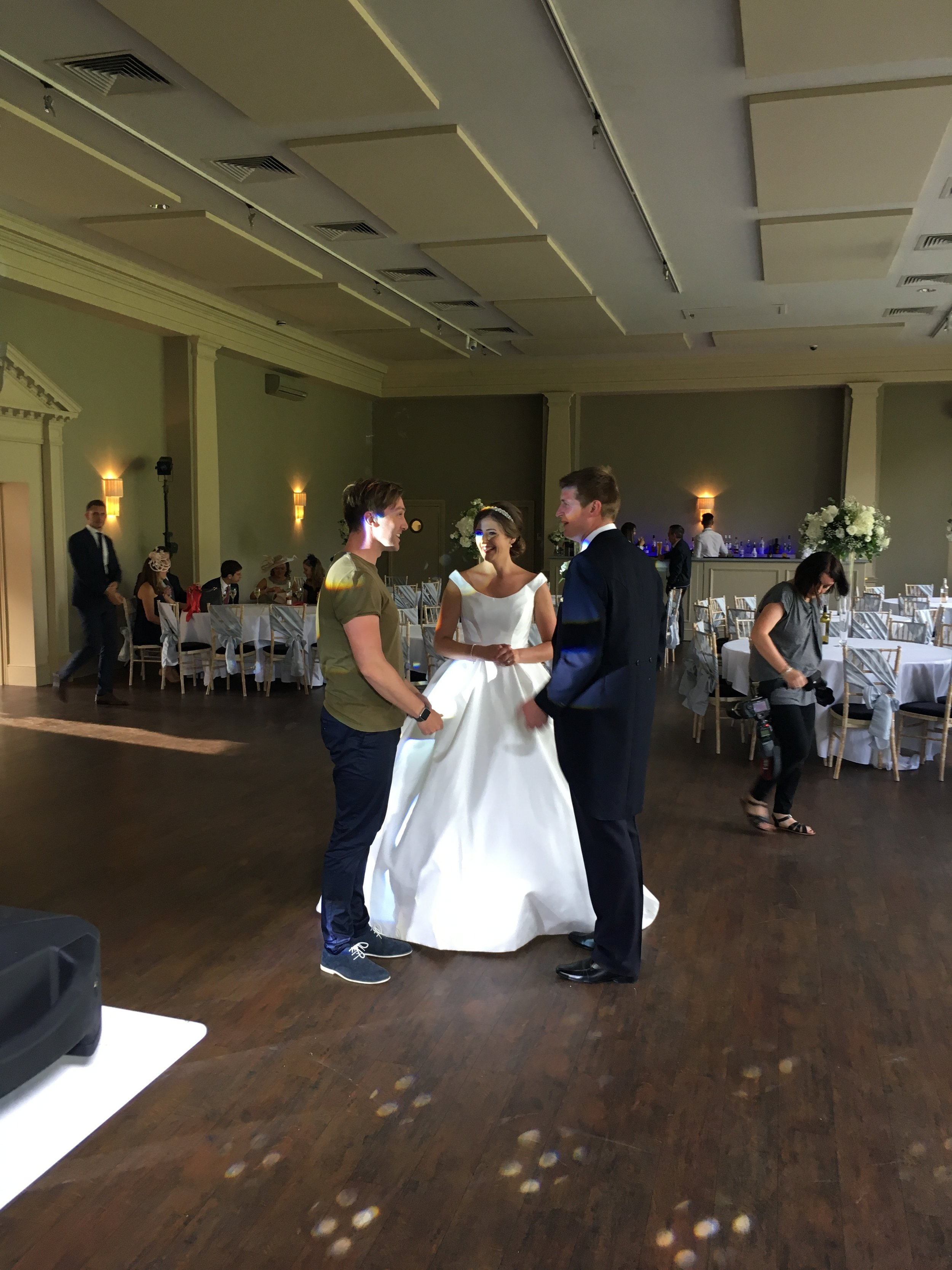 Front man, Adam Thomas, having a quick chat with the bride and groom before the evening's antics commenced!