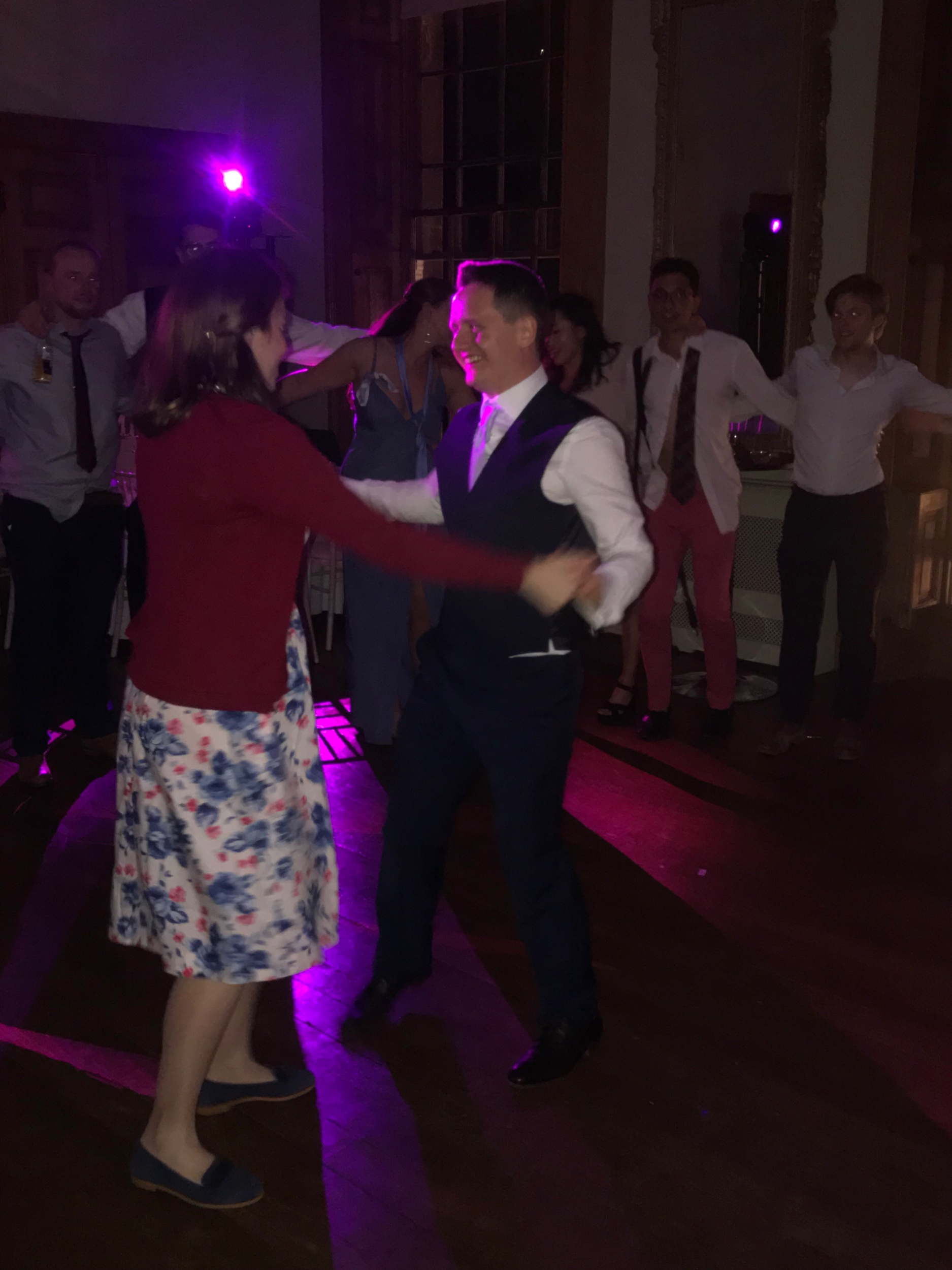 Emma and Joe surrounded by their loved ones on the dance floor, after slipping into something a little more comfortable!