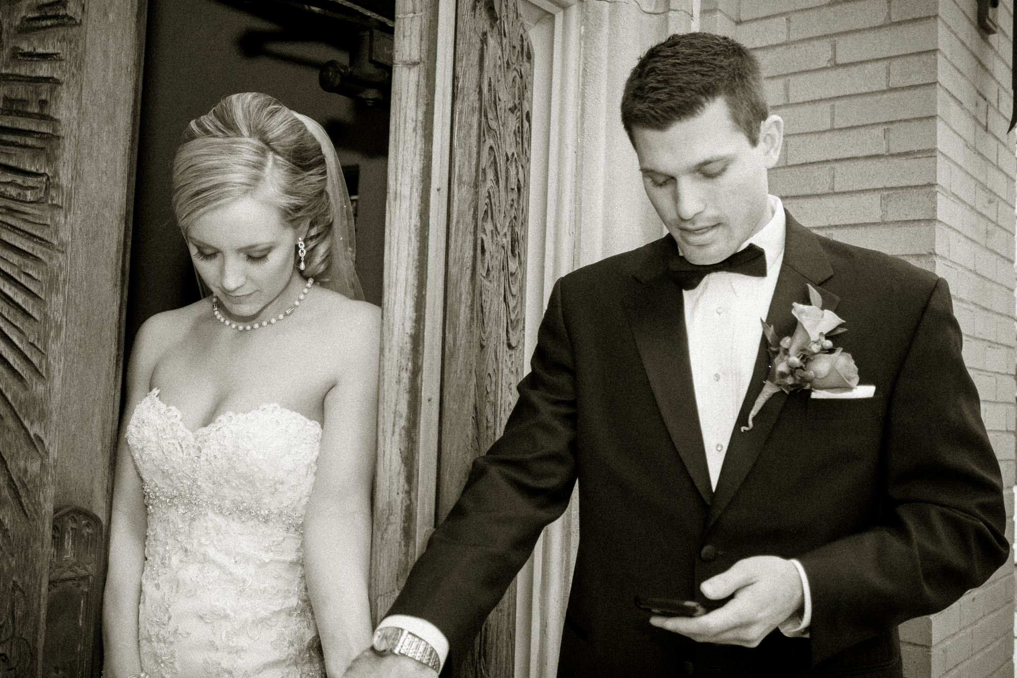A short prayer before ceremony time. The opened door assures they won't see each other until walking down the aisle.
