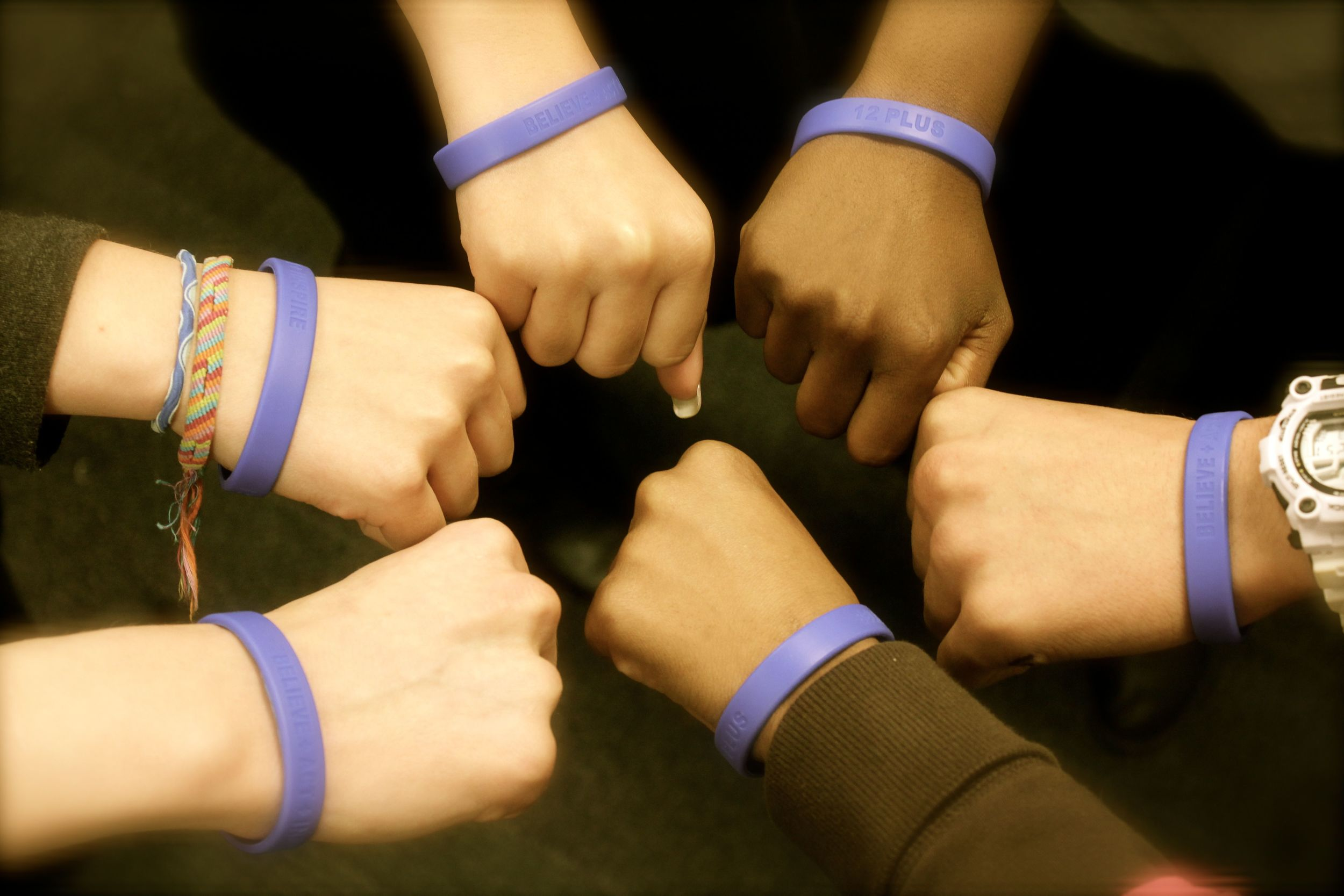 Our students rocking 12+ wristbands, which say BELIEVE + ACT + INSPIRE.