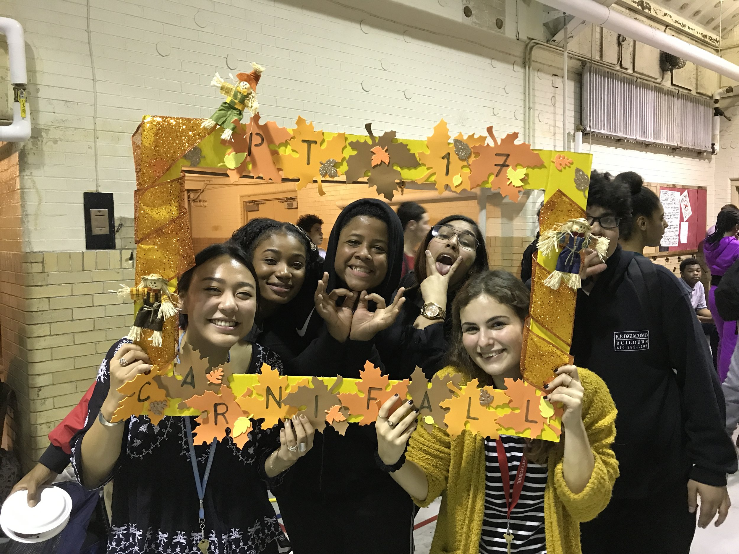 Danielle celebrates students with over 95% attendance at Penn Treaty's Carni-fall party