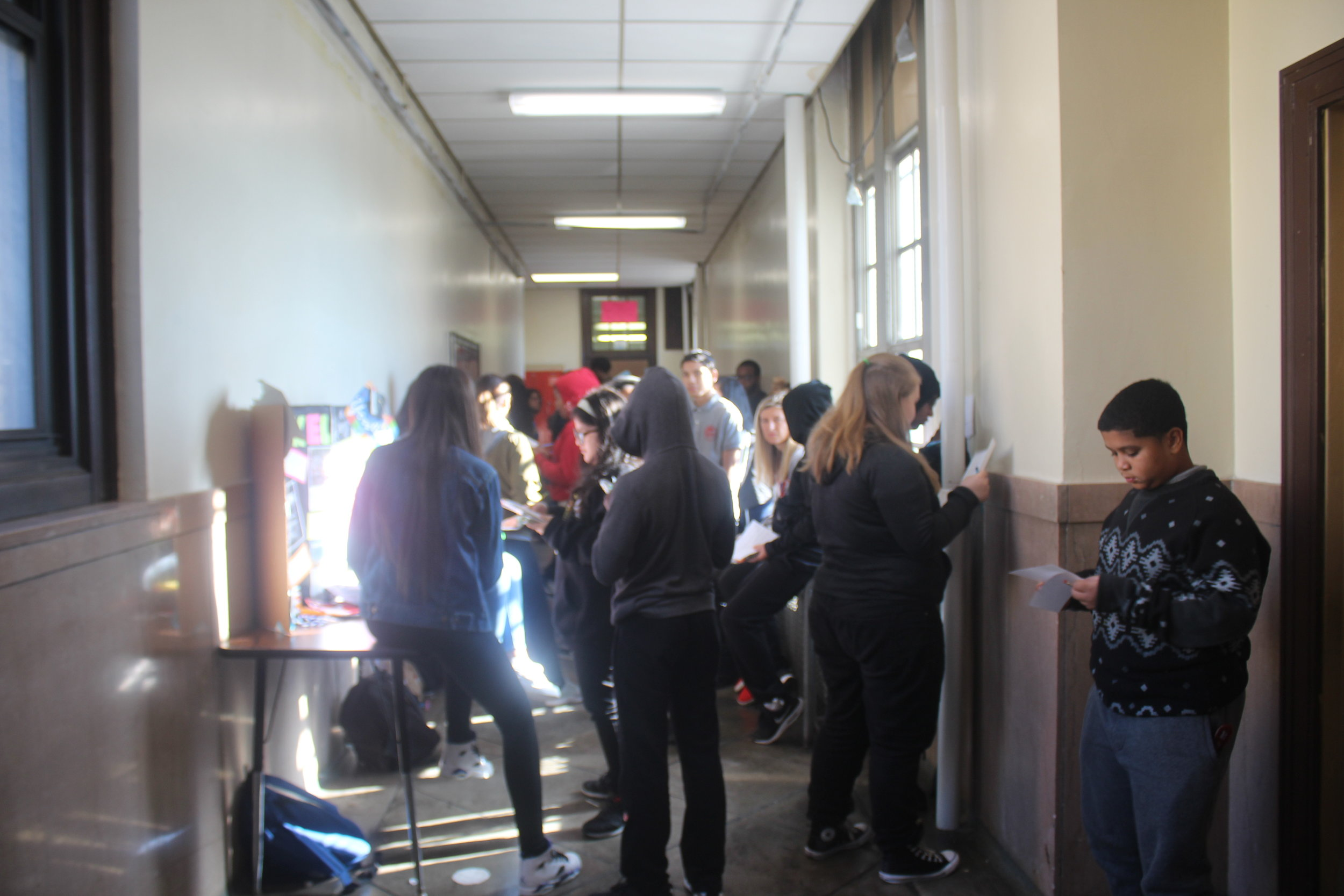 Underclassmen crowd the hallway during the Senior-run college fair.