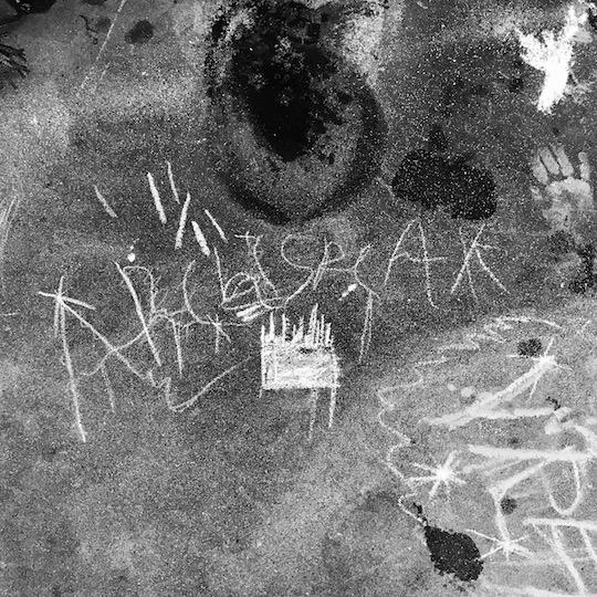 Chalk art Archispeak logo by Evan's kids