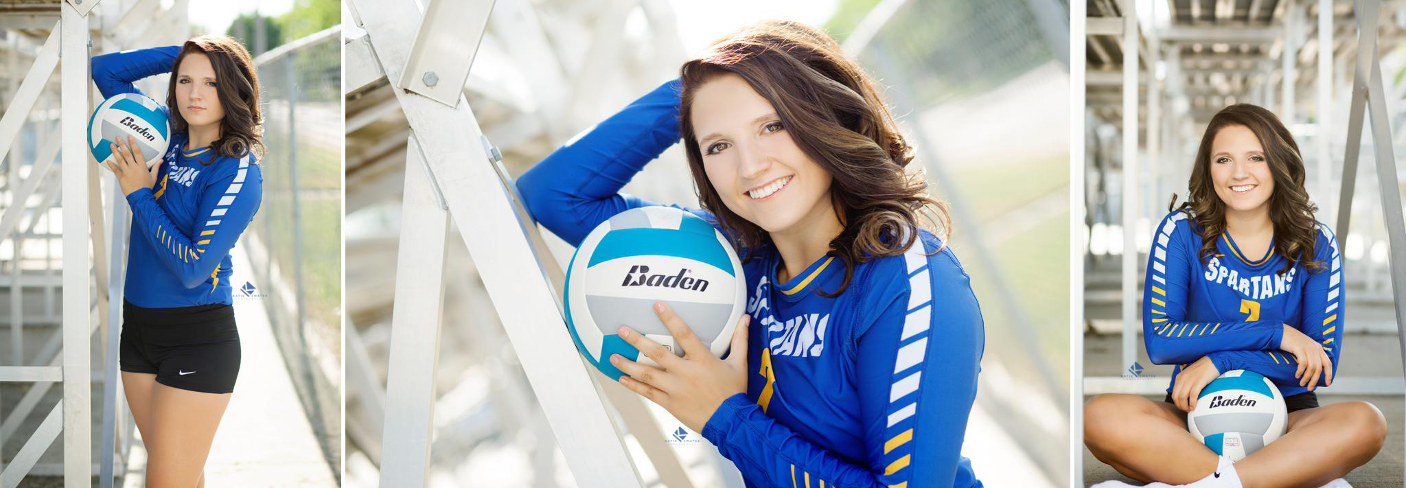 brunette senior girl in blue volleyball jersey leaning against silver bleachers