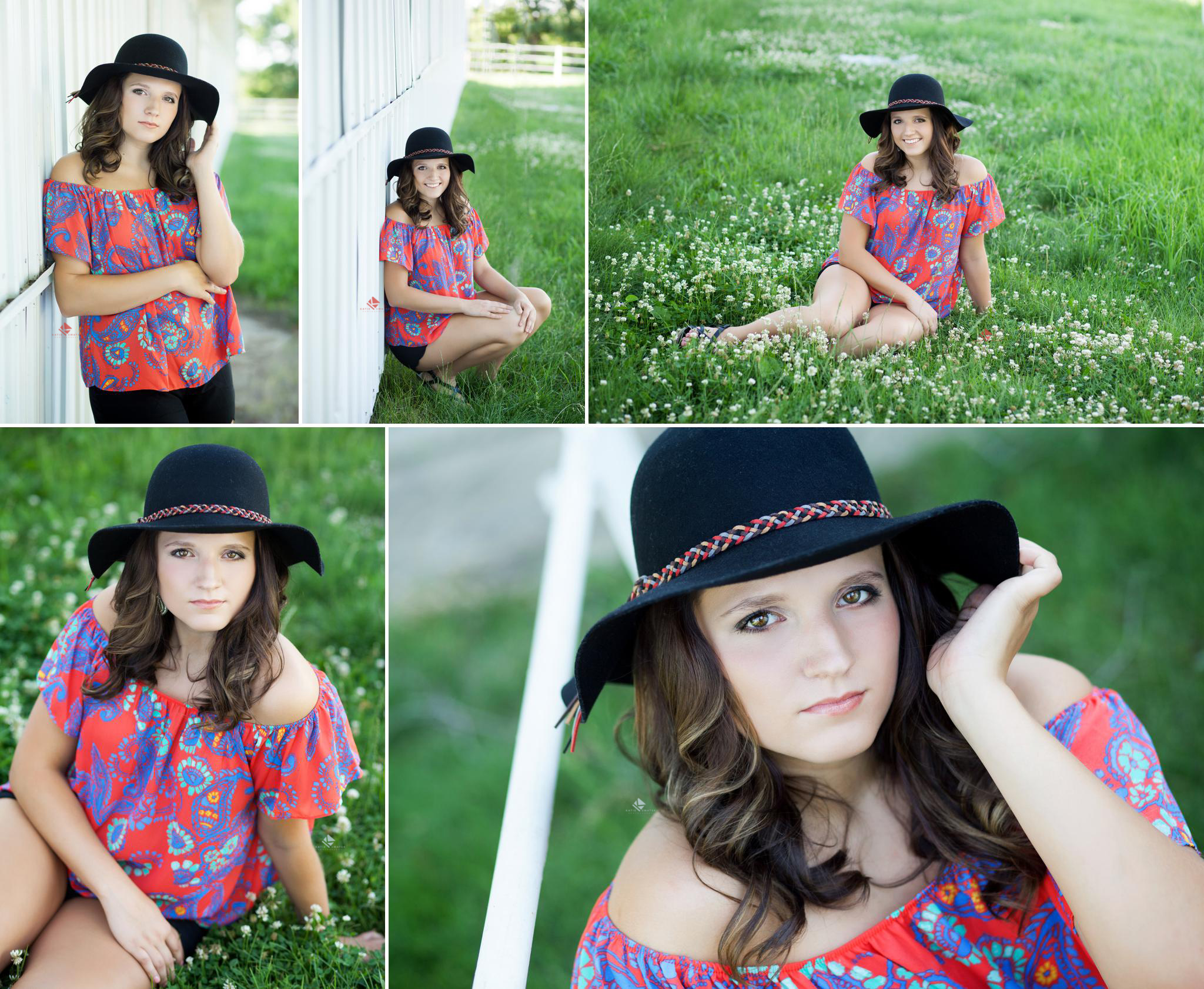 brunette senior girl in red paisely patterned shirt with black hat sitting in grass and leaning against white building