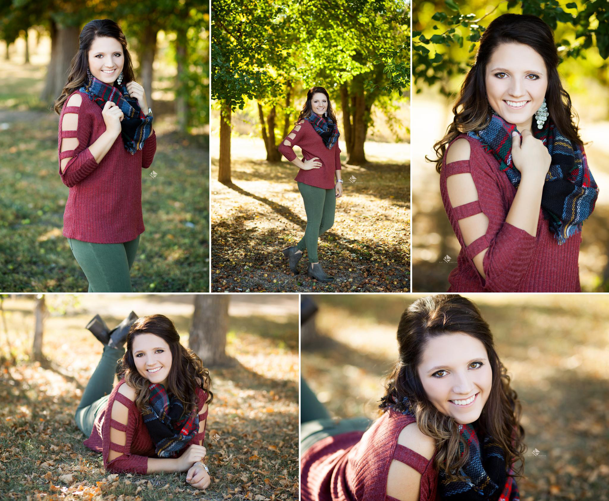 Brunette senior girl stands underneath fall trees in the middle of a treeline in South Dakota the senior is wearing a cutout burgundy sweater and olive pants