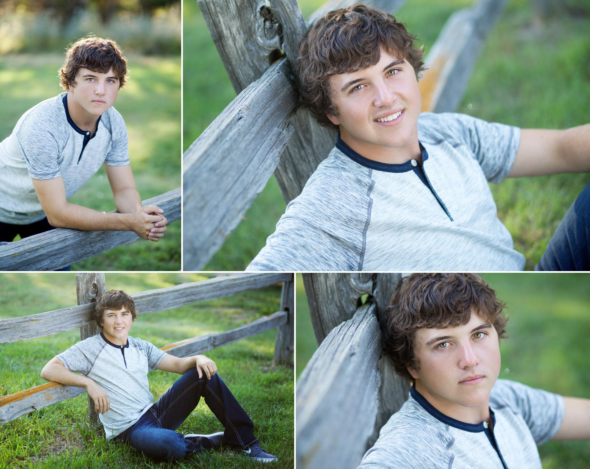 brunette senior boy in a gray baseball tee sitting next to a wooden fence in green grass
