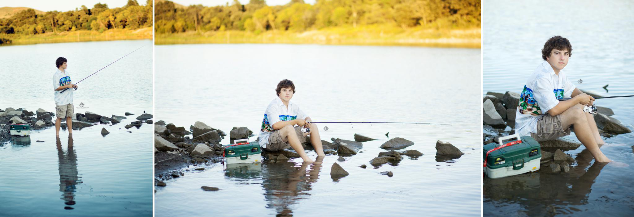 Brunette senior boy in Hawaiian shirt standing in the river with a fishing pole and tackle box