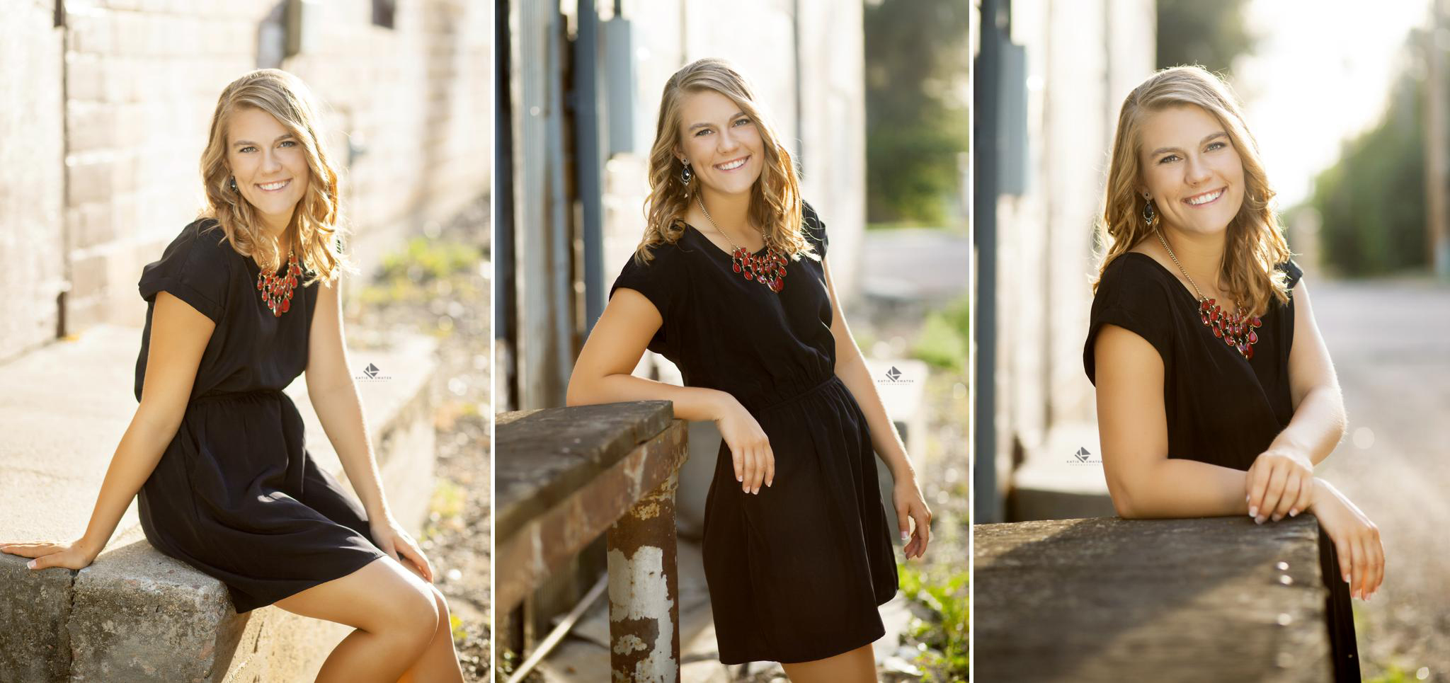 blonde senior girl in a black dress in an urban alleyway