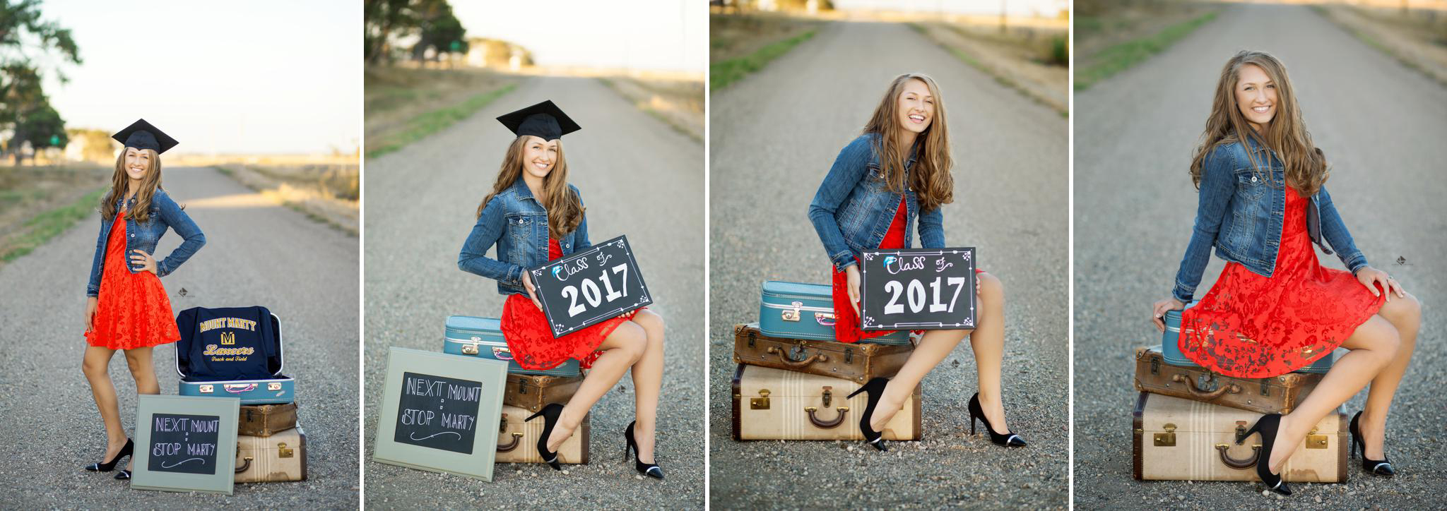 blonde senior girl in a red dress and a denim jacket sitting on old suitcases on an old dirt road in her graduation cap