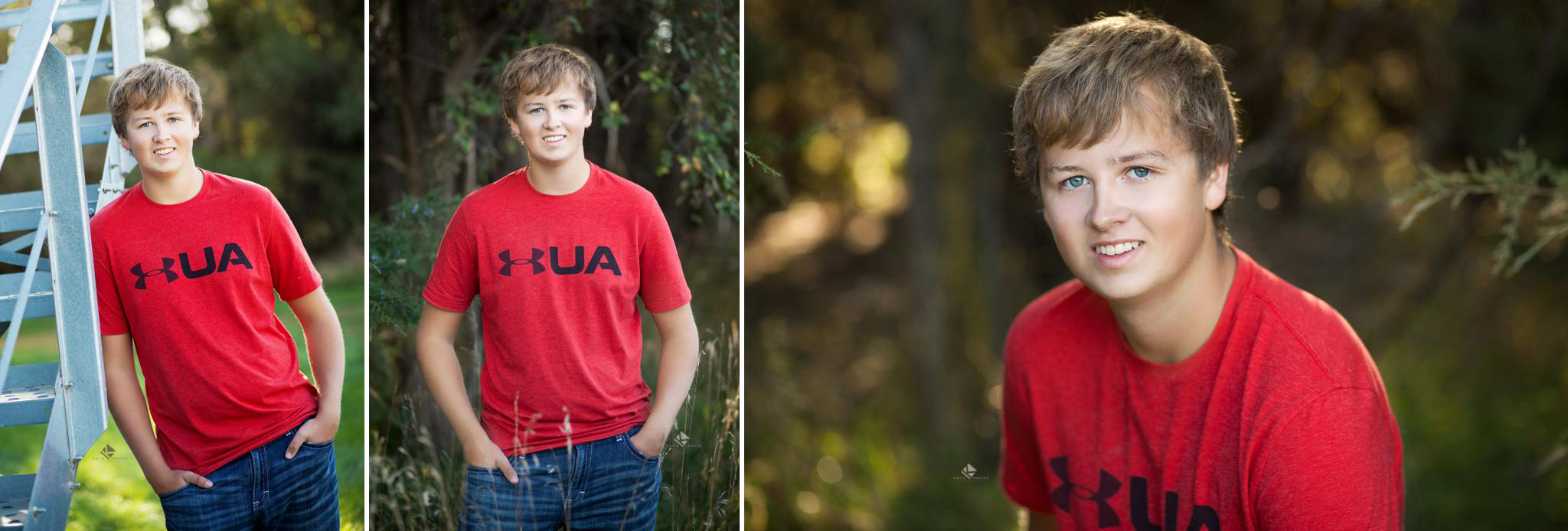 blonde senior boy in a red t shirt and jeans standing next to a grain bin and in some trees.