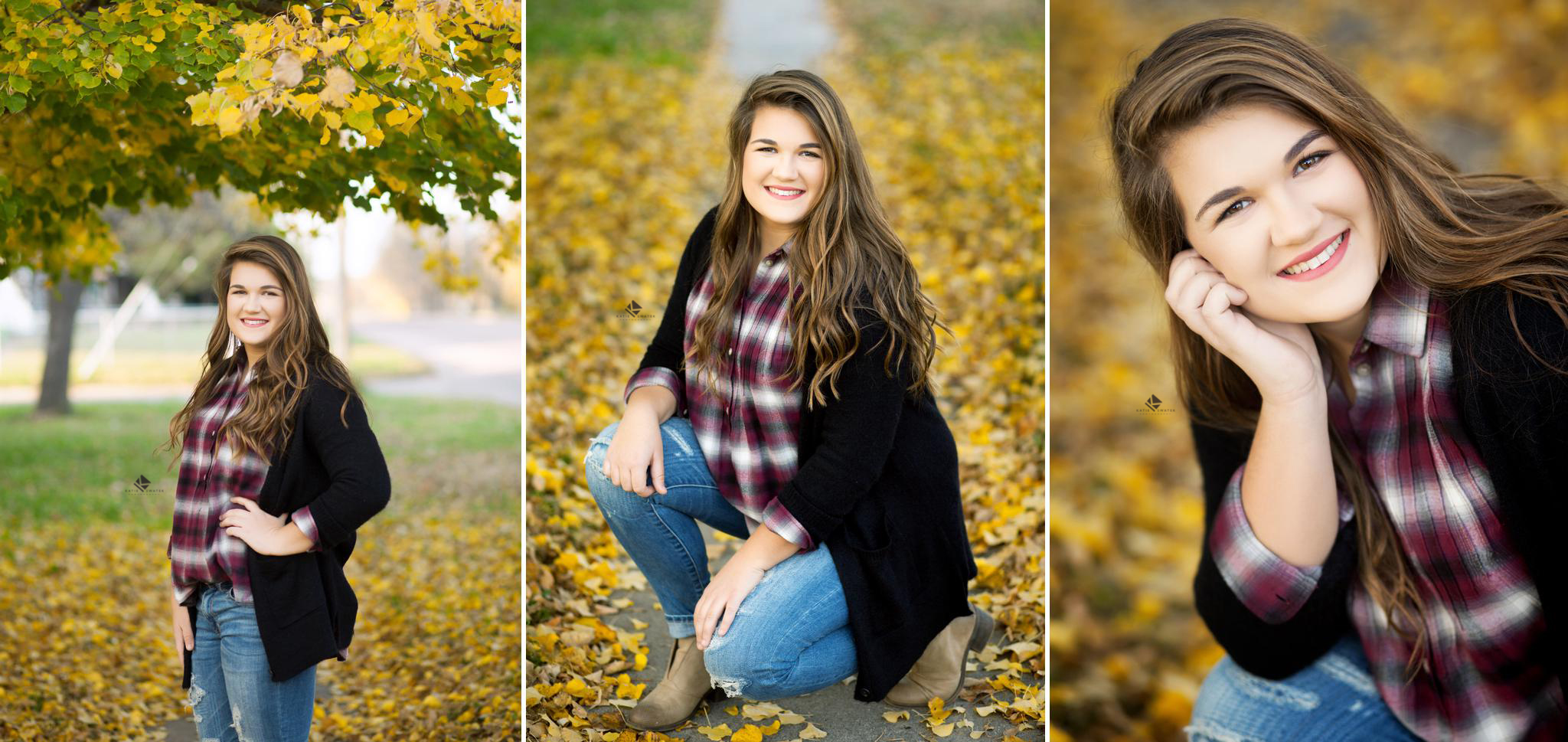 brunette senior girl in a maroon plaid shirt with a black cardigan posing for senior pictures by a yellow leafed tree in the fall