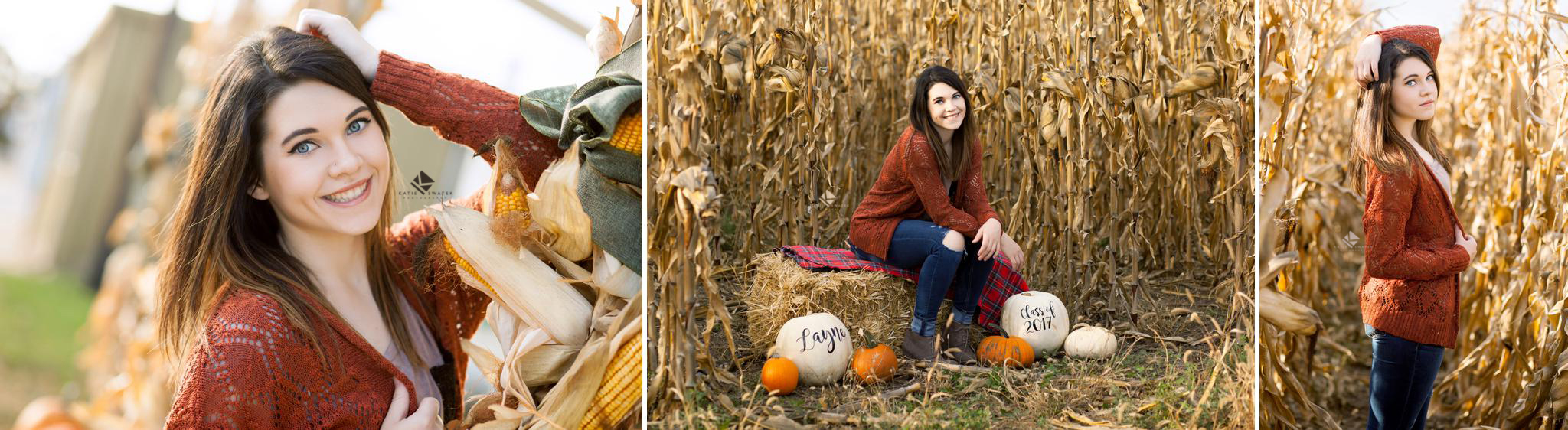brunette senior girl in a burnt orange cardigan posing in a corn field for senior pictures in Nebraska
