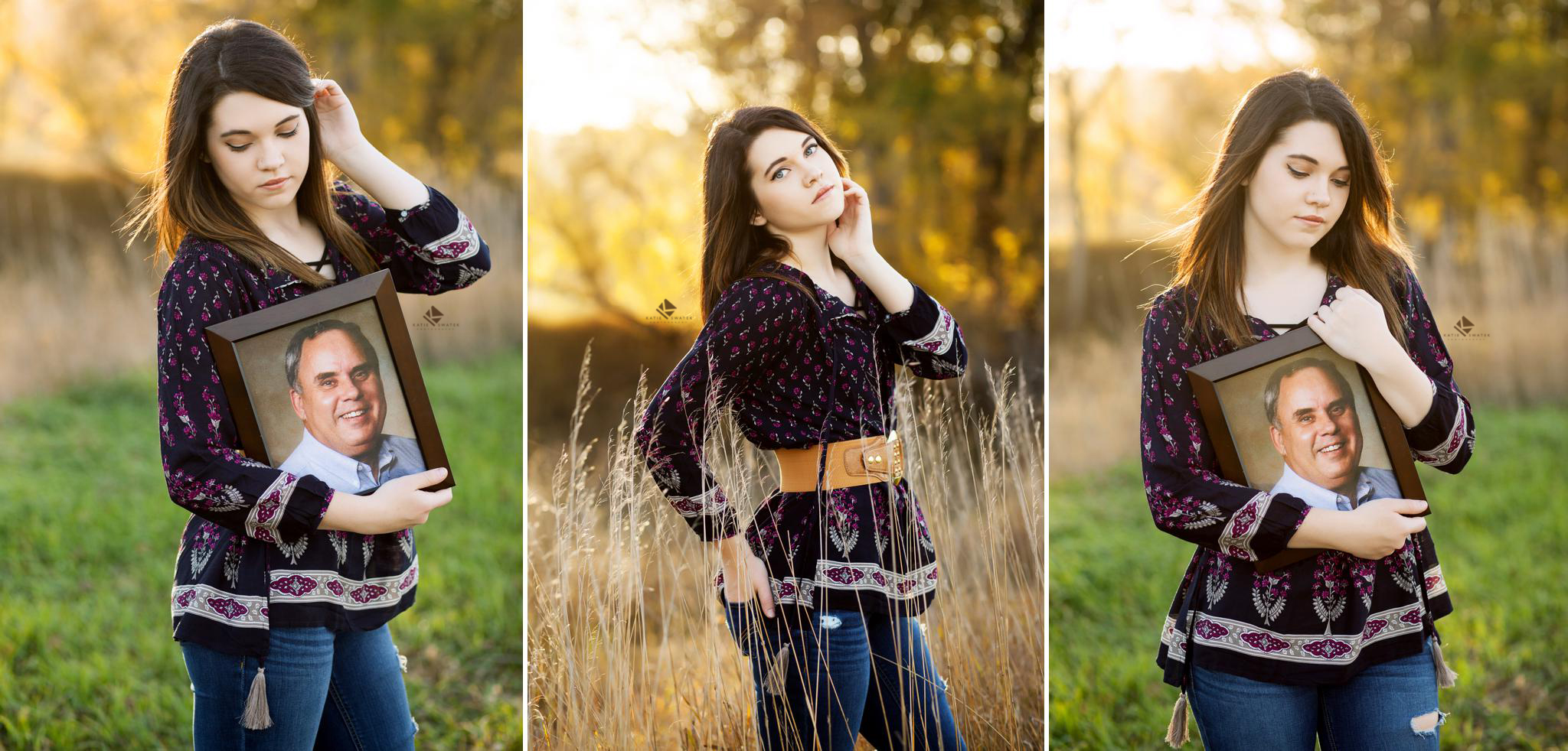 brunette senior girl in a blue, belted paisley top holding pictures of her deceased grandfather in a tall grass field