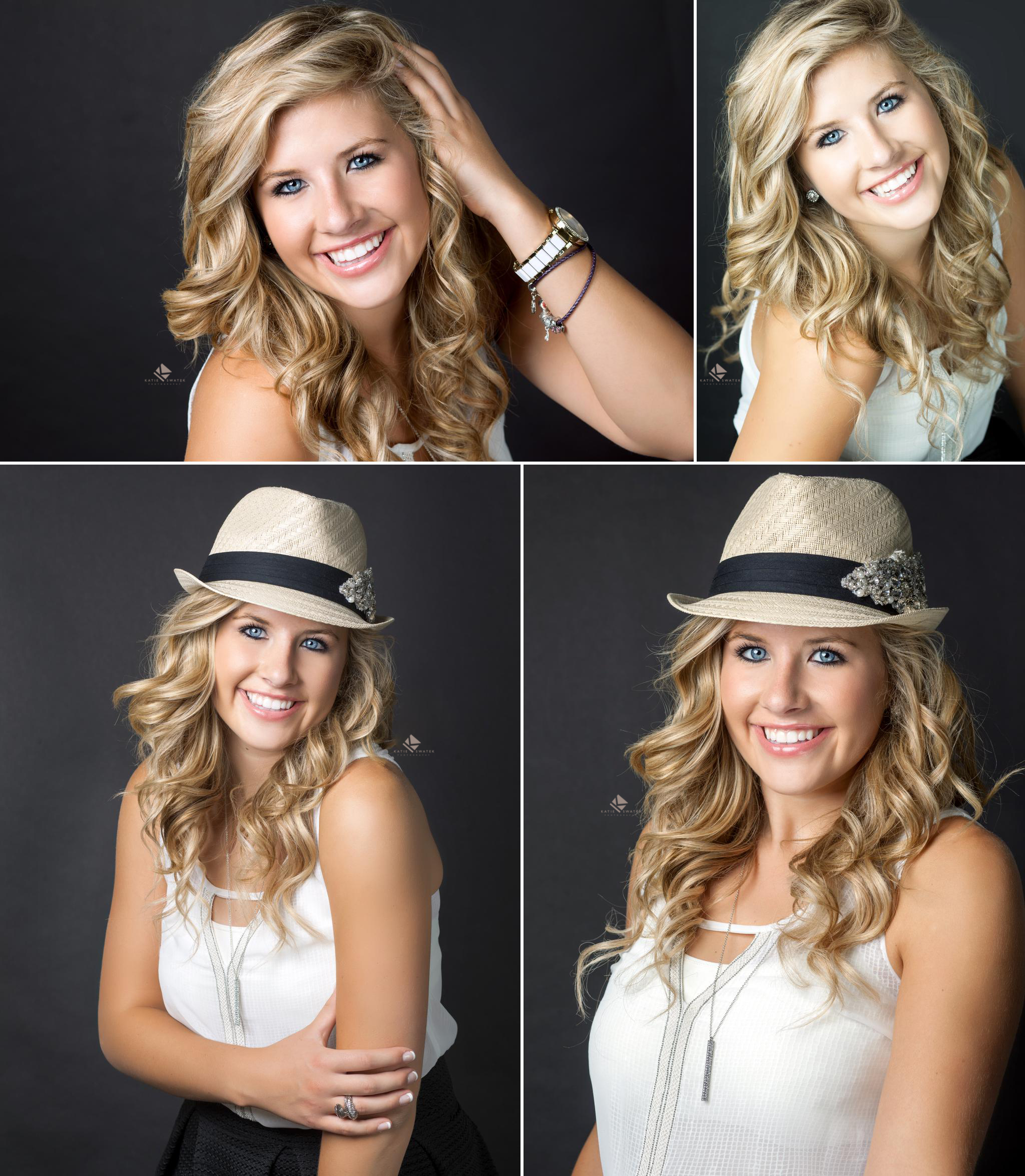 blonde senior girl in a white shirt and fedora photographed in a studio on a black backdrop