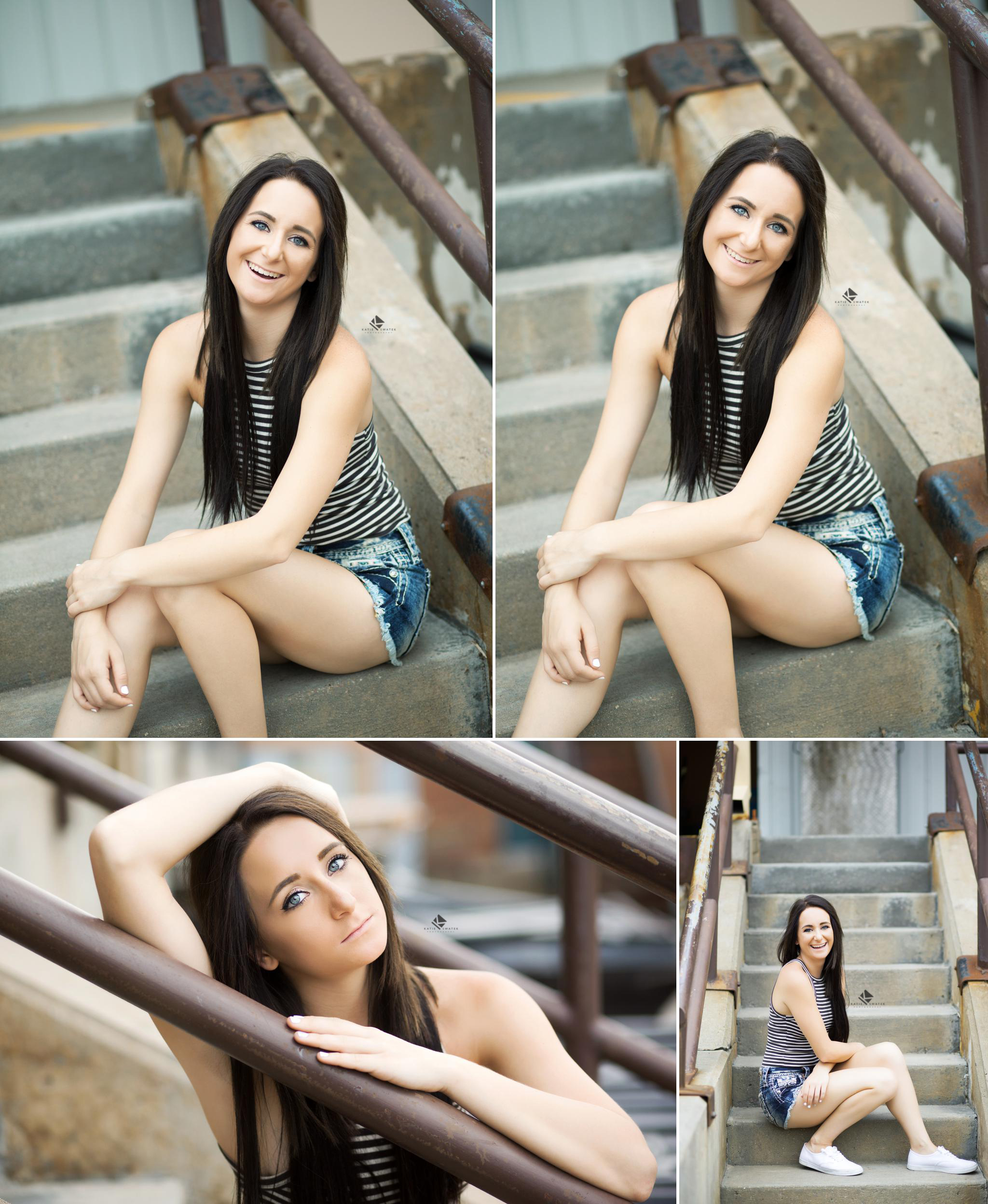 brunette senior girl in a black and white striped top and denim cutoffs posing on cement stairs in an urban location in Wagner SD