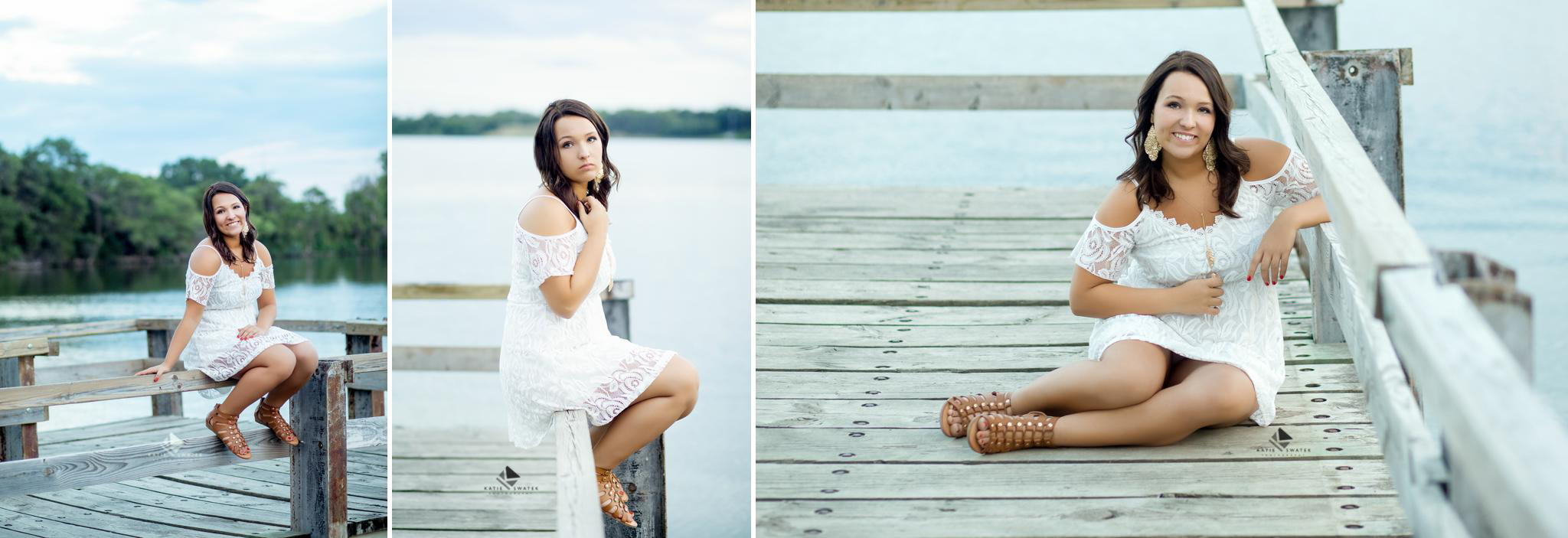 brunette senior girl in a white lace dress sitting on the rails of a dock overlooking Lake Mitchell