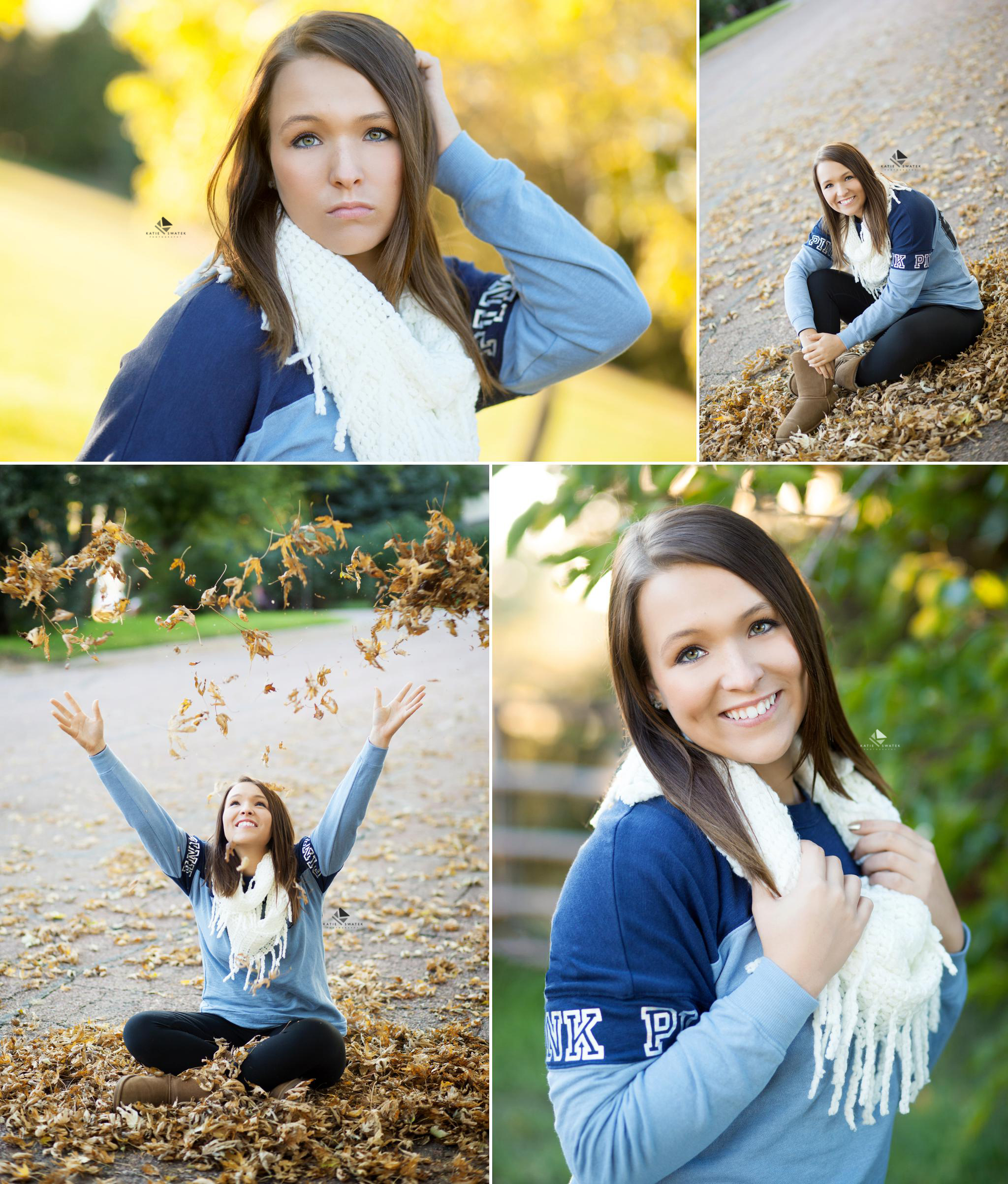 brunette senior girl in a blue sweatshirt and white scarf throwing fall leaves and standing in front of a yellow leafed tree