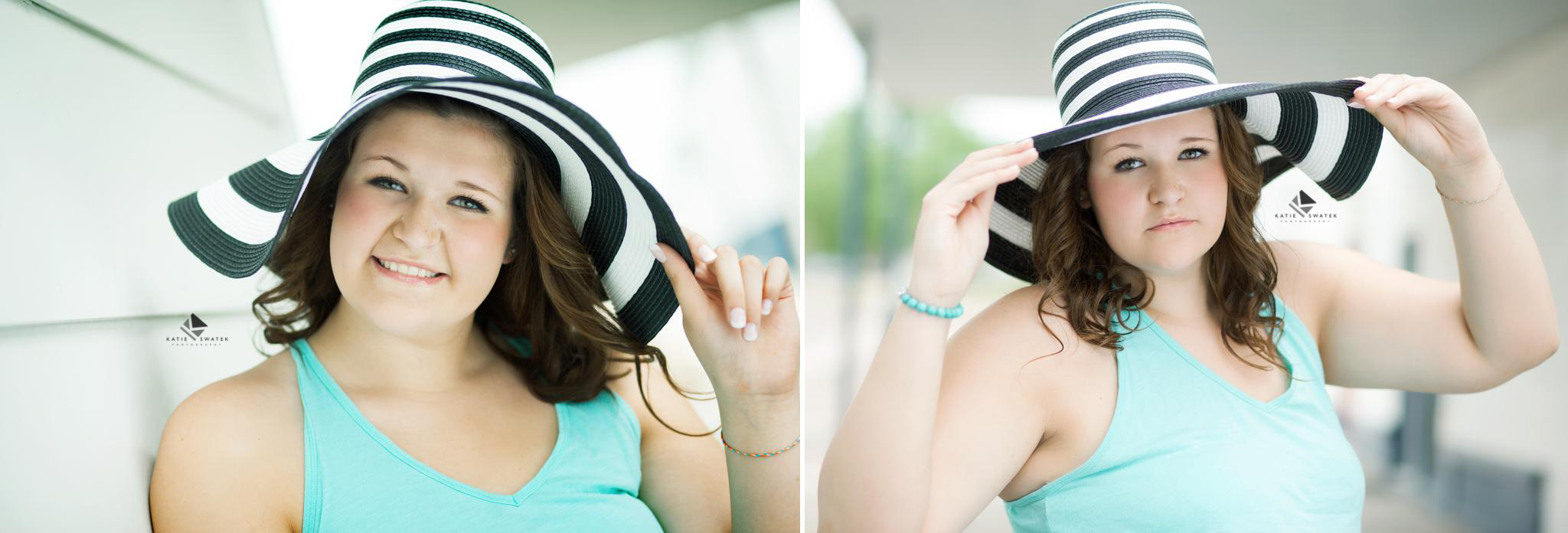 brunette senior girl in a blue tank top and a black and white striped hat in a white alley setting