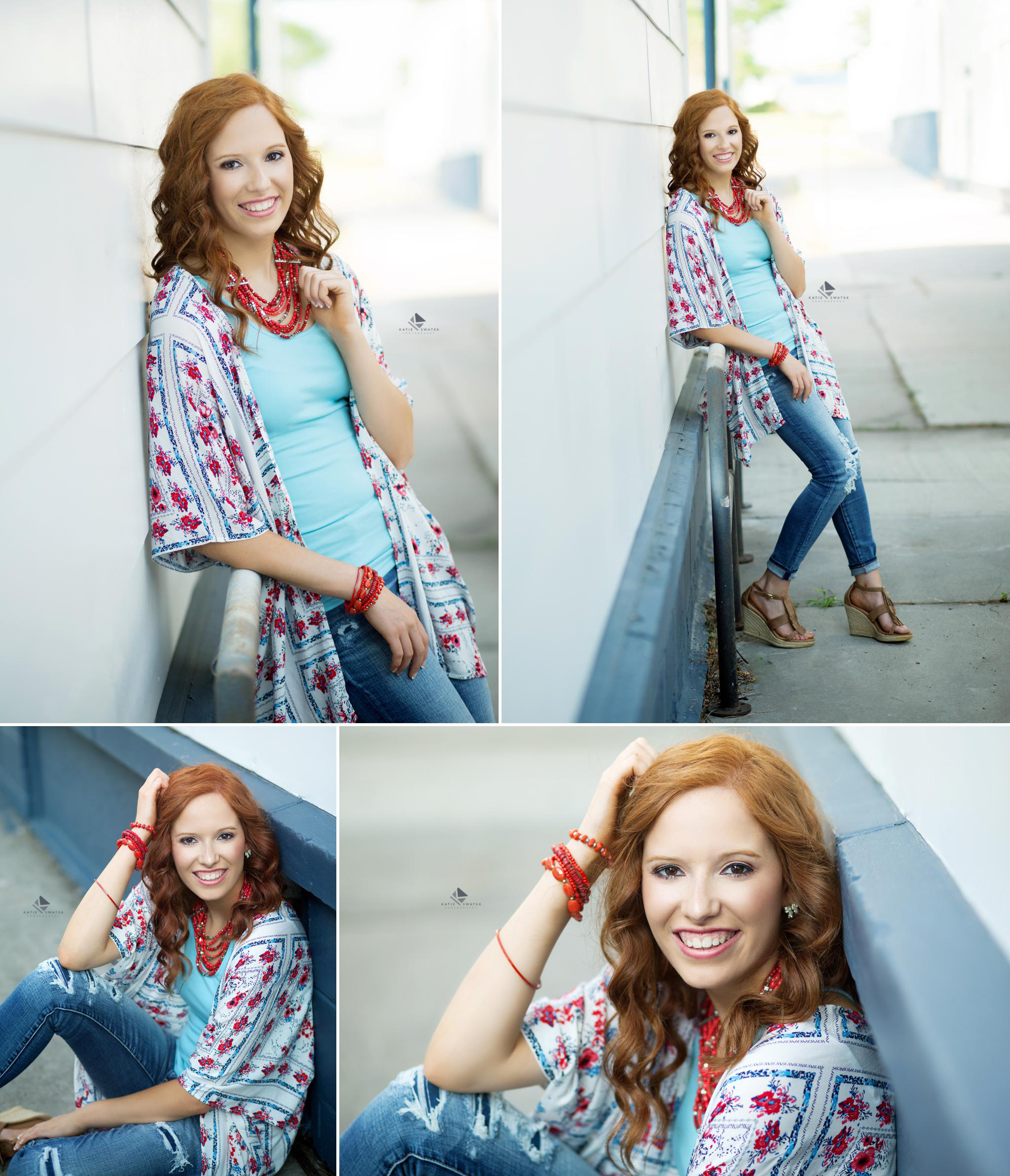 red headed senior girl in a floral kimono and jeans posing on a white and blue wall