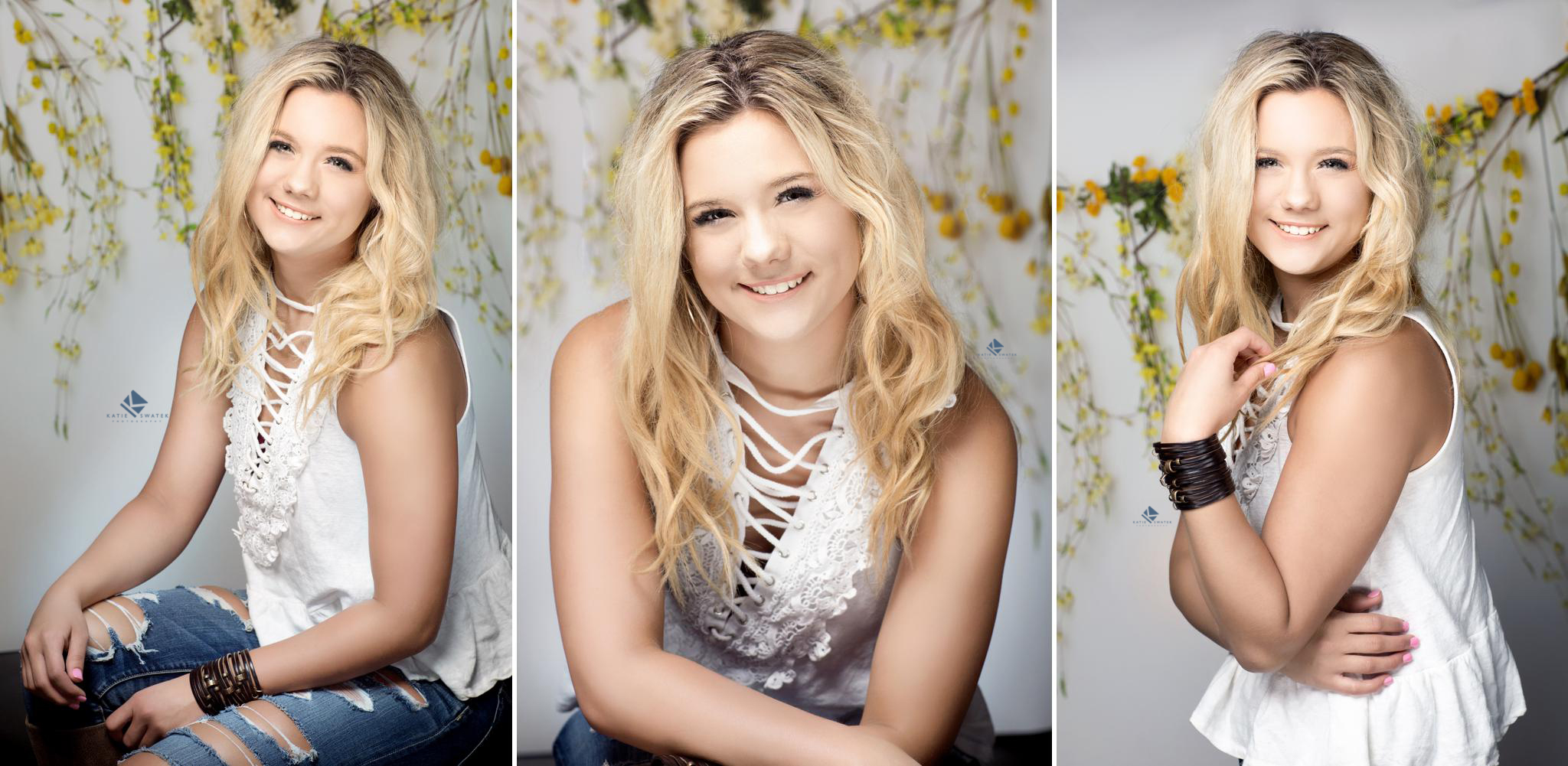 blonde senior girl posing in front of a white backdrop with yellow florals in the studio in Wagner South Dakota by Katie Swatek Photography