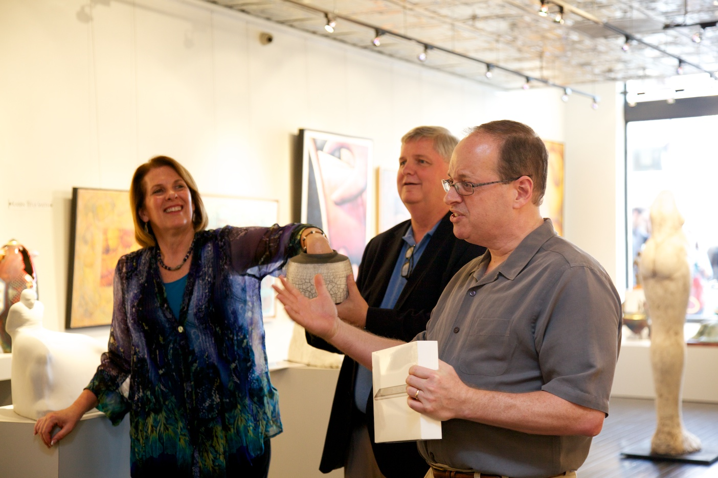 Door prize drawing  President Margaret Offermann, Gallery Director Perry Magee, and Chairman Russell Medford