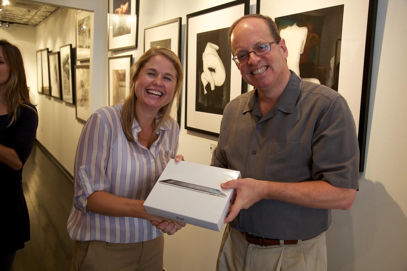 Winner of iPad raffle, Sydney Godfrey of PBI Commercial Interiors, and gallery chairman, Russell Medford