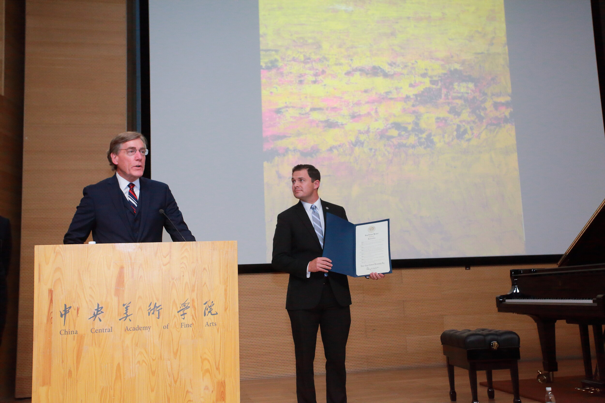 Brad Herbert presents the declaration of Utah-China Cultural Friendship Day alongside A. Scott Anderson