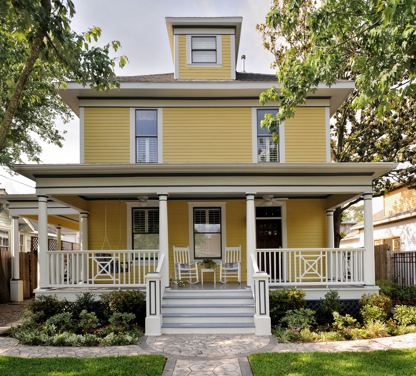 Yellow vintage style home with porch, Designer: Carla Aston