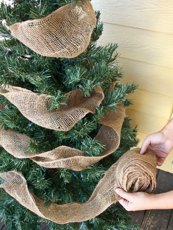 Article + Gallery ➤ http://CARLAASTON.com/designed/decorating-with-burlap For The Love Of Burlap | The Holiday's Hottest Decorating Tool (Image Source: HGTV - KWs: decor, tutorial, DIY, Christmas, tree)