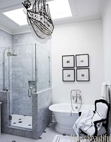 Article + Gallery ➤ http://CARLAASTON.com/designed/lighting-makes-artistic-statement When Lighting Makes A Design's Artistic Statement - Image Source: House Beautiful (KWs: light art, chandelier, bathroom, white )