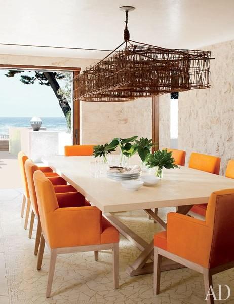 Article + Gallery ➤ http://CARLAASTON.com/designed/lighting-makes-artistic-statement When Lighting Makes A Design's Artistic Statement - Image Source: Architectural Digest (KWs: light art, chandelier, orange chair, dining room )