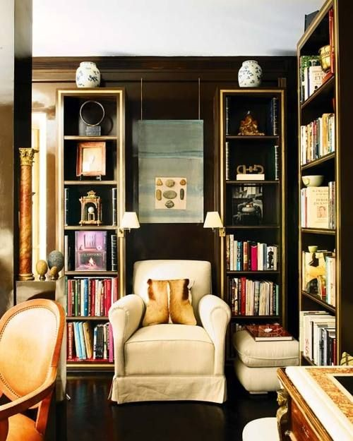 Notice how only one object is used on top of these tall, slender bookcases, kind of like a crown of sorts. It makes them seem taller, kind of like an architectural topper of some kind. Designer: Magdalena Aguilar, via:  Nuevo Estilo