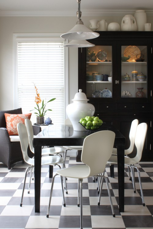 I love how these ginger jars are massed together, Had they been black like the cabinet, they would have caused the furniture piece to overpower the space. The cabinet would've appeared HUGE and the things on top would have looked crowded. Designer:  Sean Michael Design, via: houzz