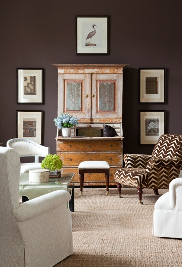Imagine if that piece of art had not been hung above the cabinet. The cabinet would've appeared really short and squatty in the room. Designer:  James Michael Howard
