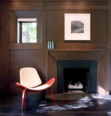 Dark wood modern paneling and fireplace surround |  Eisner Murray
