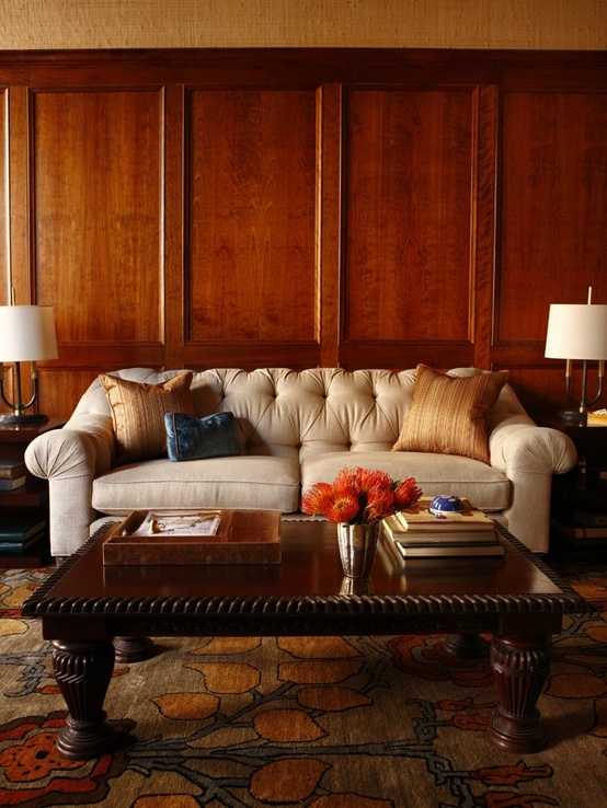Beautiful wood paneling with white sofa | Designer:  Ashli Mizell