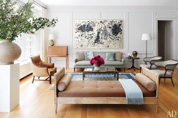 Elegant daybed used out in the open space of the living room for extra seating | Image Source:  Architectural Digest , Home of Nina Garcia