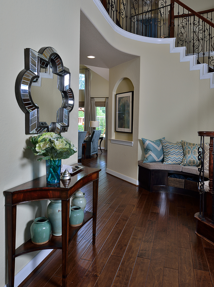 Furnishings, a new built-in entertainment center, and some finishing touches helped complete this entry hall designed by Carla Aston, giving a young family a clean, contemporary look with colorful accents and fresh style that compliments personality perfectly.