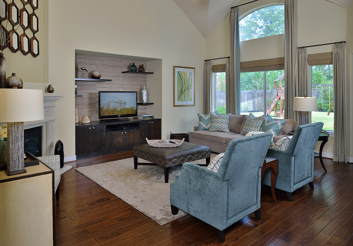 Furnishings, a new built-in entertainment center, and some finishing touches helped complete this living room designed by Carla Aston, giving a young family a clean, contemporary look with colorful accents and fresh style that compliments personality perfectly.