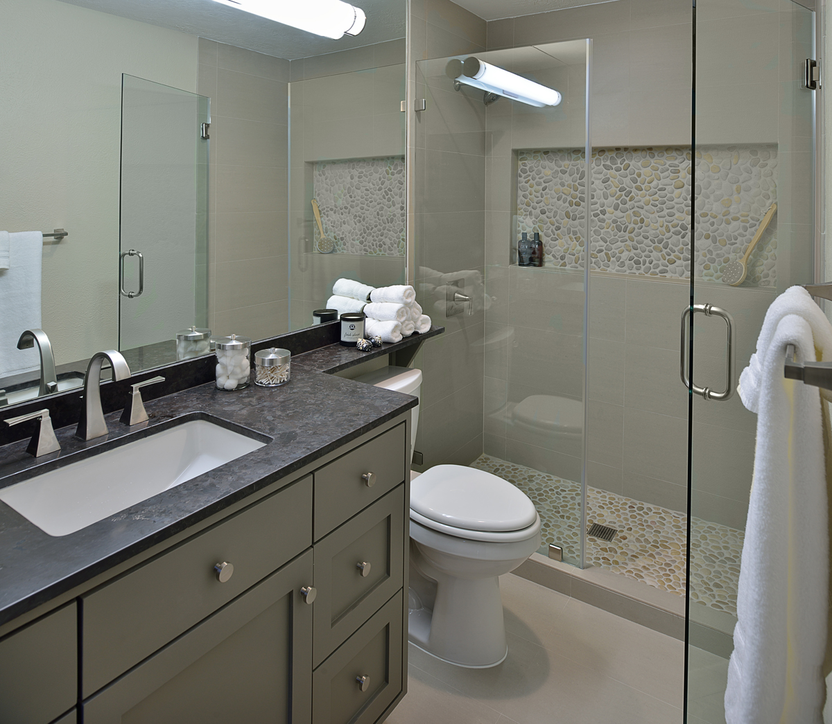 Carla Aston, interior designer, remodels a bachelor's dated bathroom.