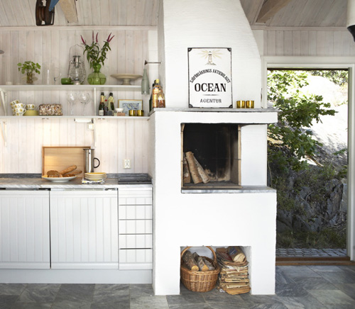 Fireplaces in the kitchen | Image via:  The Style Files