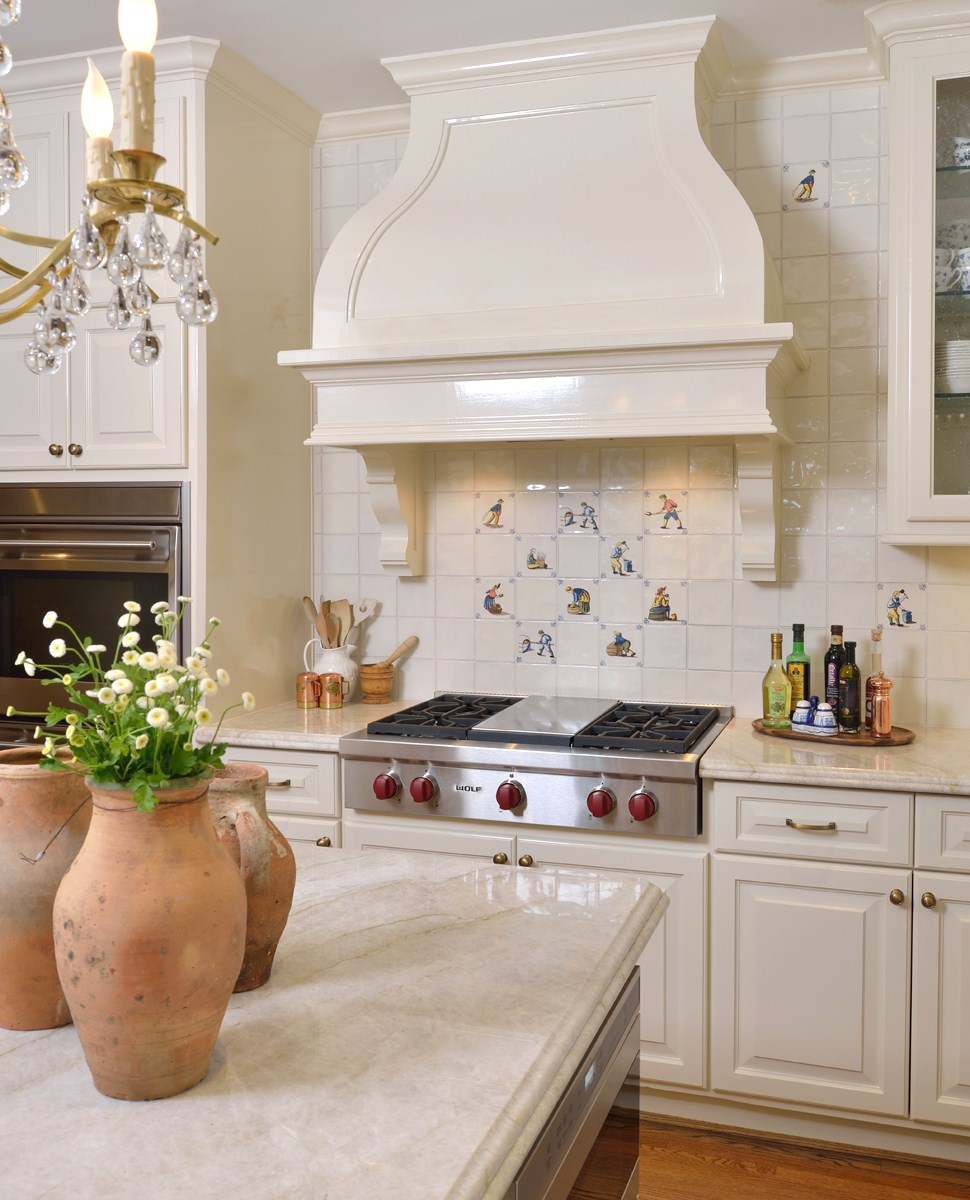 The cooking wall: We moved the oven down the wall -- adjacent to the door -- to make space for a grander hood and more room at the new cooktop. Carla Aston, Designer | Miro Dvorscak, Photographer #kitchenhood #kitchendesignideas #traditionalkitchen