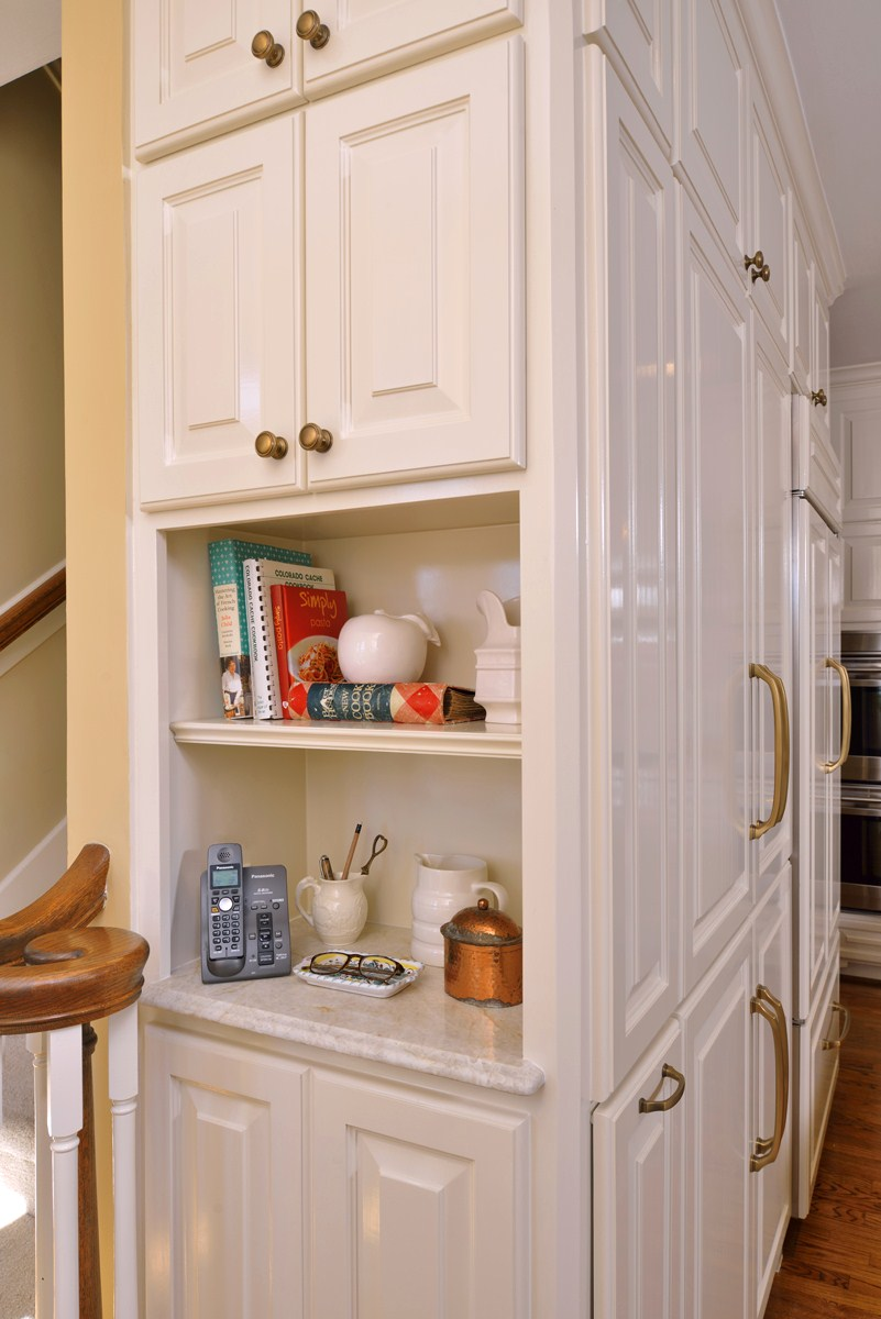 The small desk:Previously unused (except as a place for the house telephone), the desk was removed and a small niche was created at the end of the cabinetry.
