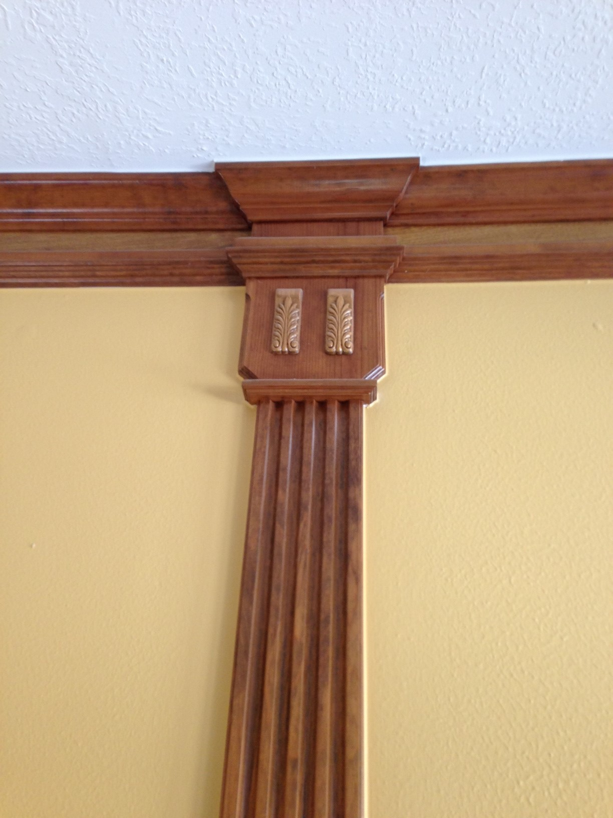 """This fluted moulding with the """"enhanced"""" capital is too skinny and looks cheap.   Mouldings can be a beautiful thing. However, many times they're not."""
