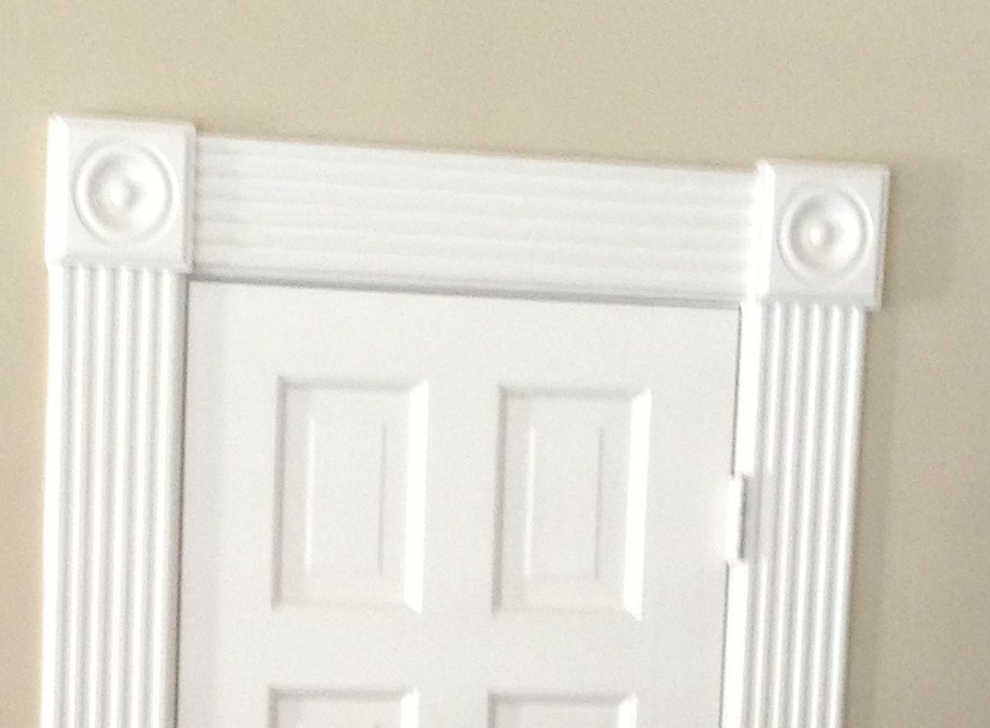 Here's an example of oversized door trim that feels overdone in a suburban home.