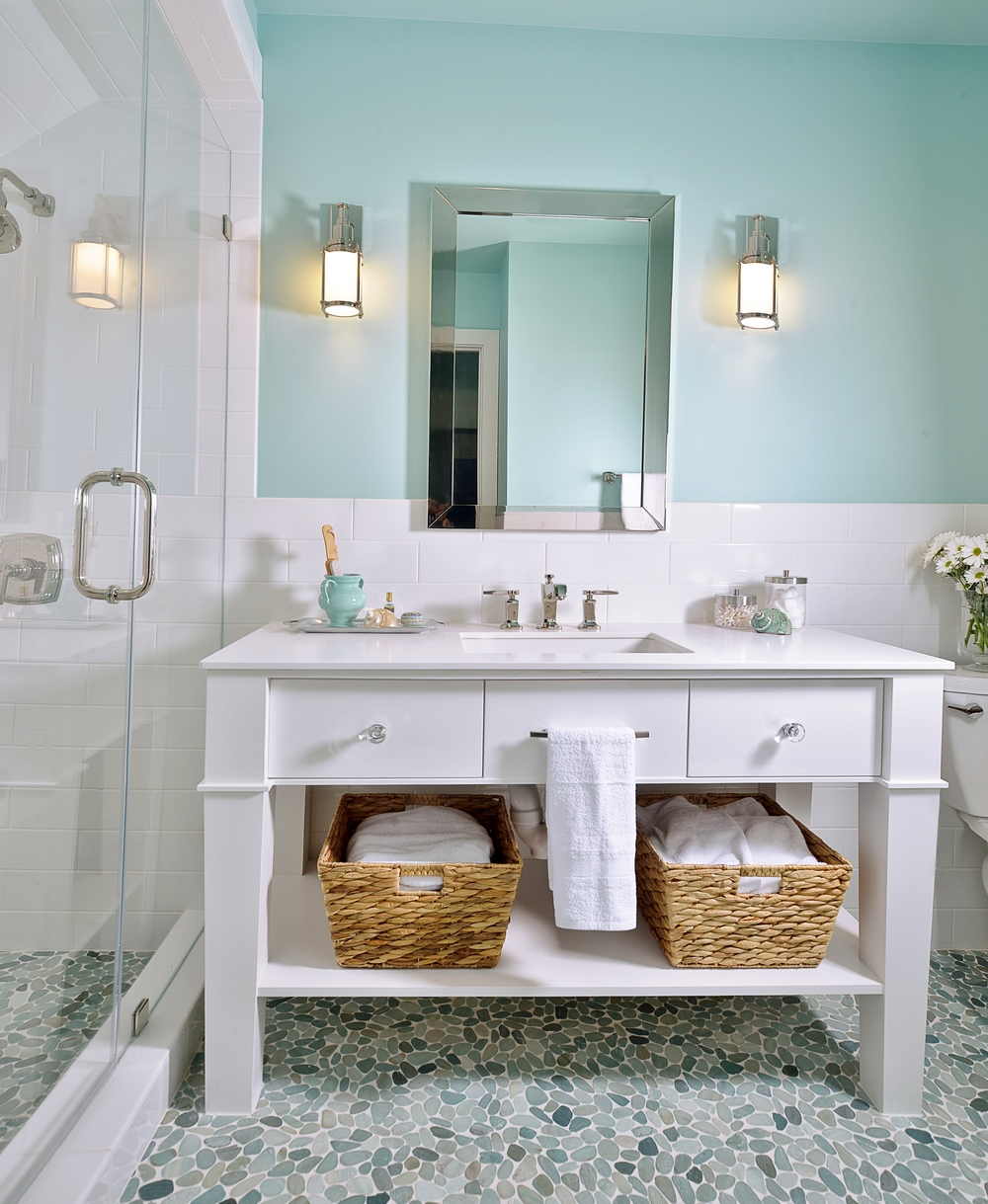 Sconces work well with the mirrored medicine cabinet in this feminine bathroom. Carla Aston, Designer #bathlight #vanitylight #wallsconce