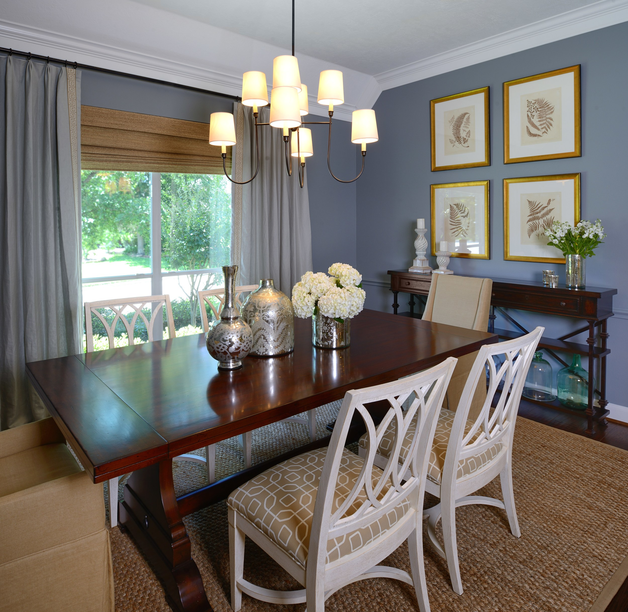 Blue dining room with white chairs, Designer: Carla Aston