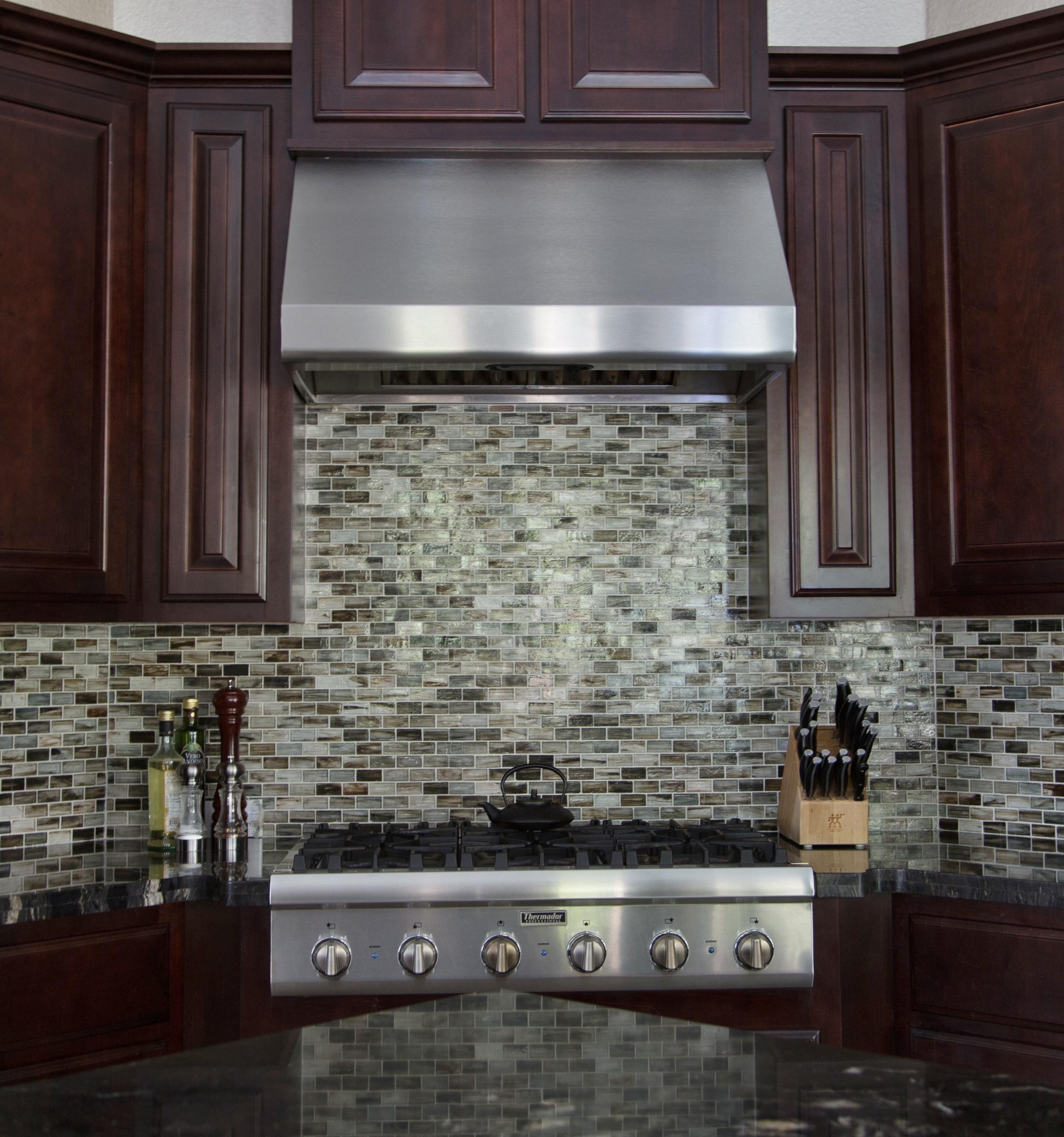 Dark, dramatic kitchen remodel by interior designer Carla Aston
