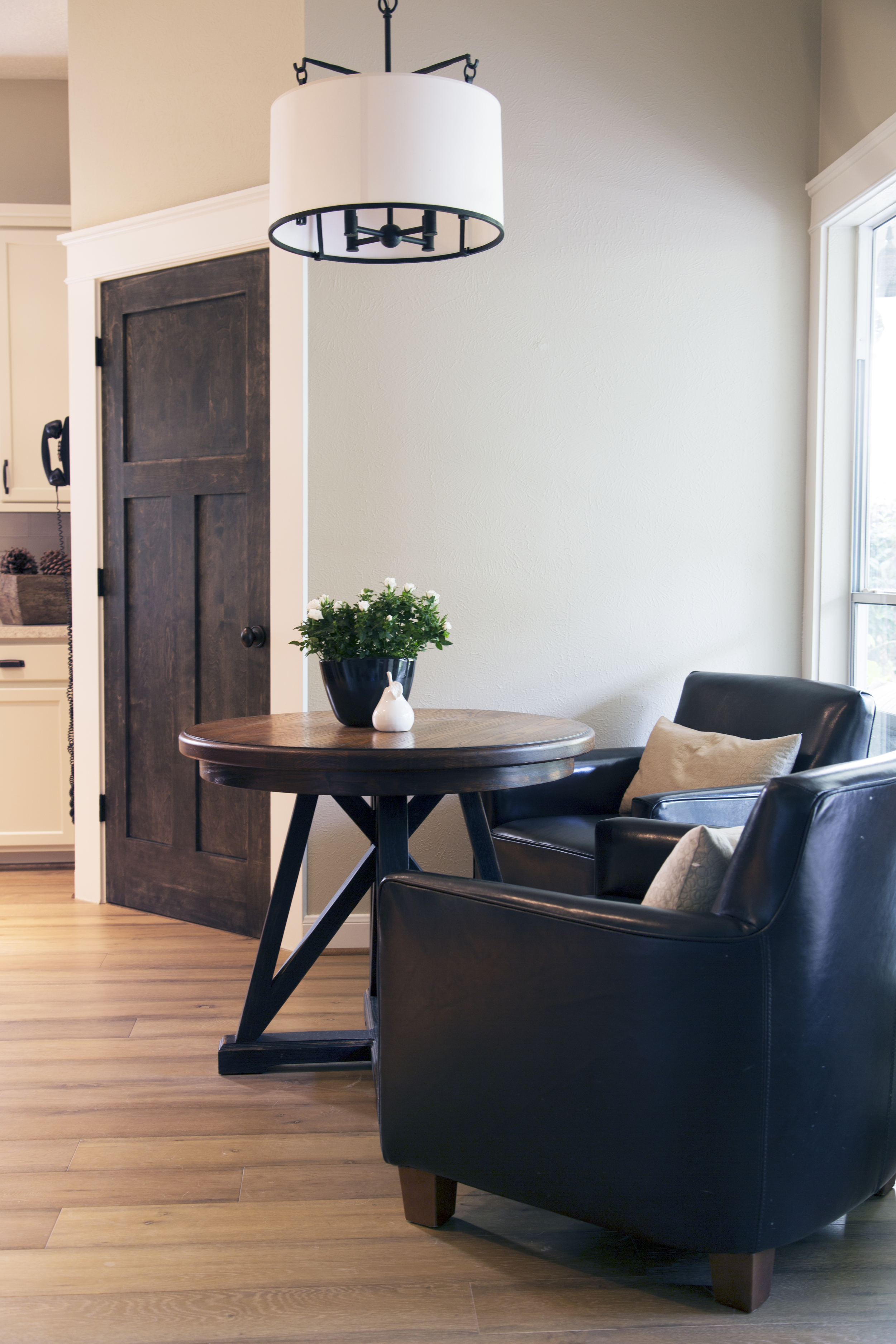Interior design -ed by Carla Aston, interior designer / Photography by Tori Aston | Home kitchen renovation-remodel-makeover; rustic, coffee house style; leather chair; wood floor; table.